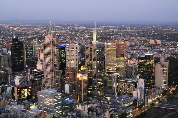 Melbourne city at night - learn about living in Melbourne.