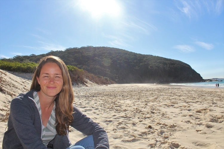 Travel blogger on Elizabeth Beach in NSW Australia.