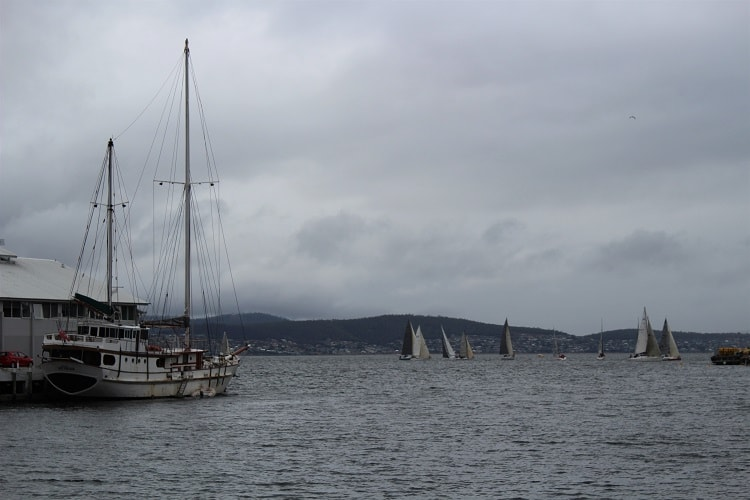 Hobart climate showcased in a cloudy, harbour shot.
