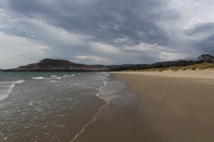 Moody, atmospheric photo of Seven Mile Beach in Hobart.