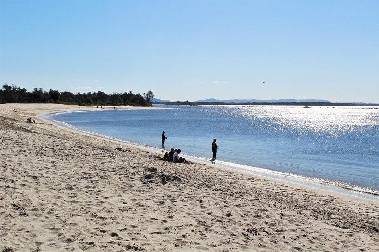 Fishermen at Whiting Beach, Yamba, NSW, Australia.