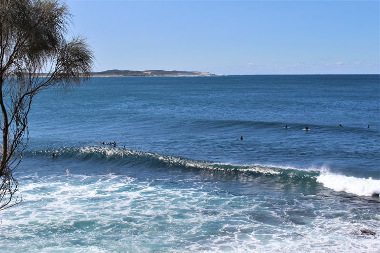 Cronulla surfers viewed from the beach walk.