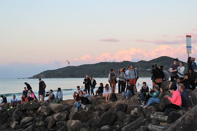 Gathering at The Wreck, Byron Bay, to watch the sunset.