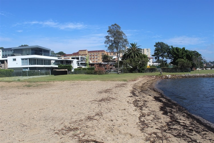 A sunny day at the beach at Queen Victoria Reserve in Drummoyne, one of the best Sydney suburbs in the Inner West.