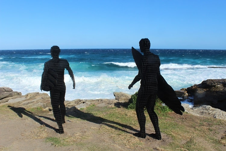 Surfer sculptures at Mackenzies Point at Sculptures by the Sea Sydney.