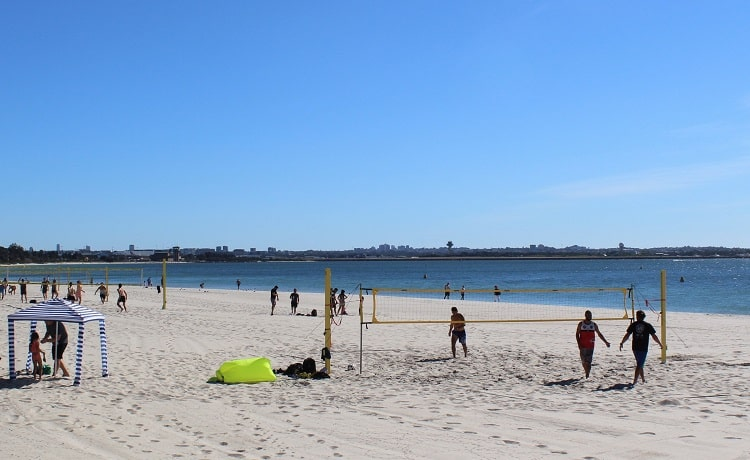 Sydneysiders playing volleyball on a sunny Sunday morning at Brighton Le Sands Beach.