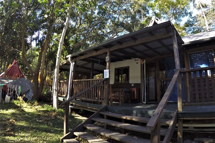 Wooden lakeside cottage at the Arts Factory Lodge in Byron Bay: backpacker accommodation.
