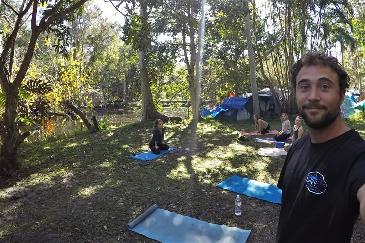 Outdoor yoga class in Byron Bay at the Arts Factory Lodge.